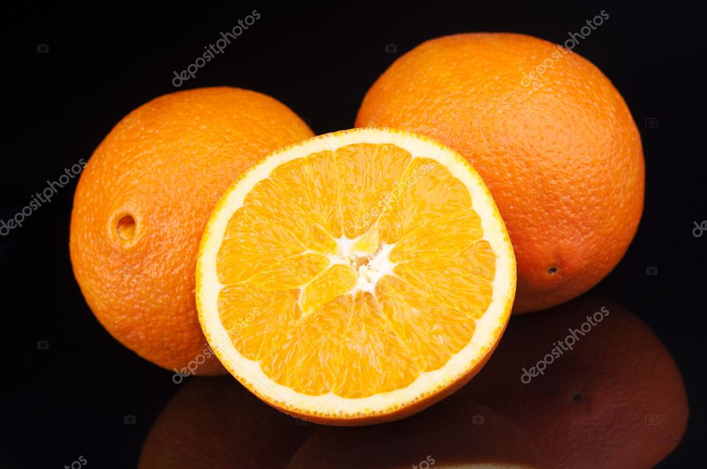 Fresh orange fruit on black background — Stock Photo #19762987