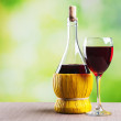 Glass of wine and bottle — Stock Photo #34963335