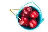 Sweet cherry in bucket — Stock Photo
