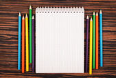 Notebook with color pencils — Stock Photo