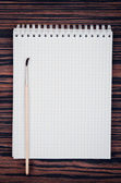 Brush for painting and notebook — Stock Photo