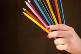 Girl holding a pencils — Stock Photo