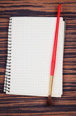 Notebook with brush — Stock Photo