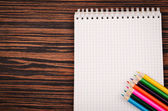 Notebook with color pencils — Stockfoto