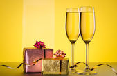 Champagne and gift — Stock Photo