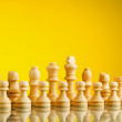 Golden chess pieces — Stock Photo