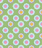 Seamless pattern of decorative flowers. Background simulates fabric stitched with thread — Stock Vector