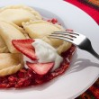 Varenyky with strawberry sauce — Stock Photo #22672151