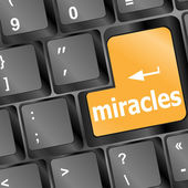 Computer keyboard with miracles text — Stok Vektör