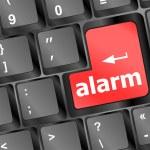 Alarm button on a black computer keyboard — Stock Vector #13874808