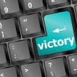 Stock Photo: Computer keyboard with victory key