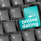 Online dating button on computer keyboard showing love concept — Stock Photo