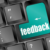 Feedback computer key showing opinion and surveys — Stock Photo