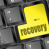 Key with recovery text on laptop keyboard — 图库照片
