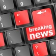 Button with breaking news text and letter symbols on keyboard — Stock Photo #18384893