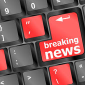 Button with breaking news text and letter symbols on the keyboard — Stock Photo