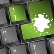 Computer keyboard with green colored enter key and blots — Stock Photo #18758263