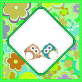 Cute baby boy owlet against the background of flowers and hearts — Stock Photo