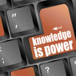 Knowledge is power or education concept with button on computer keyboard — Stock Photo