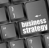 Business strategy - business concepts on computer keyboard — Stock Photo
