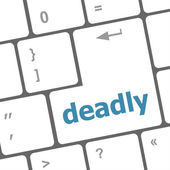 Deadly word on computer pc keyboard key — Stock Photo