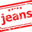 Word jeans on red rubber stamp — Stock Photo