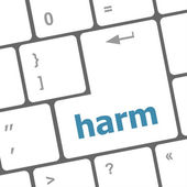Harm word on computer pc keyboard key — Stock Photo
