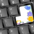 Bird and flowers on computer keyboard key — Stock Photo #25947059