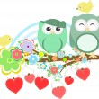Stock Photo: Two cute owls and bird on the flower tree branch