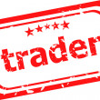 Trader on red rubber stamp over white background — Stock Photo #26939193