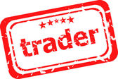 Trader on red rubber stamp over a white background — Stock Photo