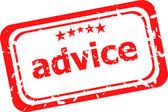 白い背景の上の赤いゴムのスタンプについてのアドバイス — ストック写真