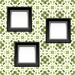 Three blank white frames on baroque wallpaper — Stock Photo