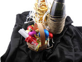 Bottle of champagne, christmas balls and white invitation paper — Stock Photo