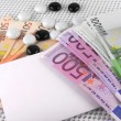 500 euros currency, white empty paper and stones — Stock Photo