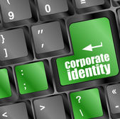 Corporate identity button on computer keyboard key — Stock Photo