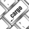 Cargo word on laptop computer keyboard — 图库照片