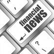 Financial news button on computer keyboard — Stock Photo