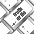 Stock Photo: Wording truth or lie on computer keyboard