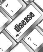 Een computertoetsenbord met toetsen spelling ziekte, leren concept — Stockfoto