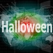 Stock Photo: Background with word halloween on digital touch screen