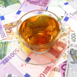 Stock Photo: Tea or cofee cup on money wallpaper