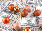 Dollars notes on christmass balls on it — Stock Photo