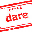 Stock Photo: Dare word on red rubber old business stamp
