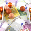 Euro notes with christmass balls on it — Stock Photo