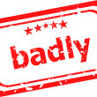 Badly word on red rubber grunge stamp — Stock Photo #34856129