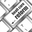 Healthy care reform shown by health computer keyboard button — Stockfoto