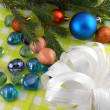Christmas decoration with stones flowers and christmas baubles — Stock Photo #35059037