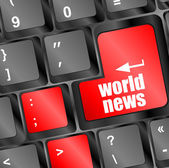 Words world news on computer keyboard key — Stok fotoğraf