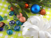 Christmas decoration with stones flowers and christmas baubles — Stock Photo